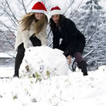 Two girls with a huge snowball