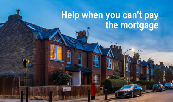 Street of terraced houses with one window lit up - what help is there when you can't pay the mortgage