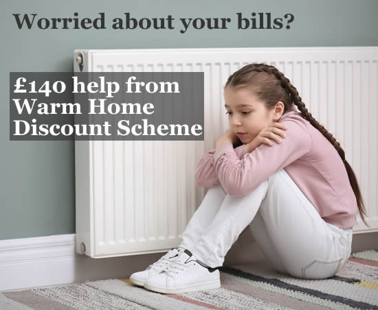 Girl sitting by a radiator because she is cold - if you are worried about your energy bills in winter 2021/22, you may be able to get 3140 help from the Warm Home DIscount Scheme
