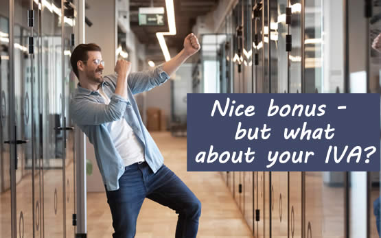 Man celebrating getting a good bonus at work - but hw is in an IVA so what will happen?